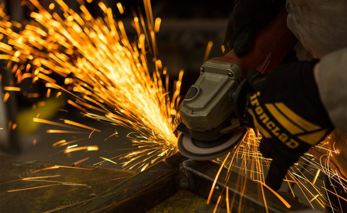 industrial-grinder-sparks-worker-safety-gloves