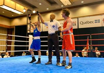 Photo of Jack Hemmings (Ont) victory over Jonathan Lahey (Que) first round victory in the 52kg. Justin Parina won the gold medal.