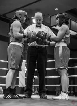Gold Medalist Melinda Watpool in her Gold medal bout at the initial face off in the ring. Photo by Vigil Barrow.