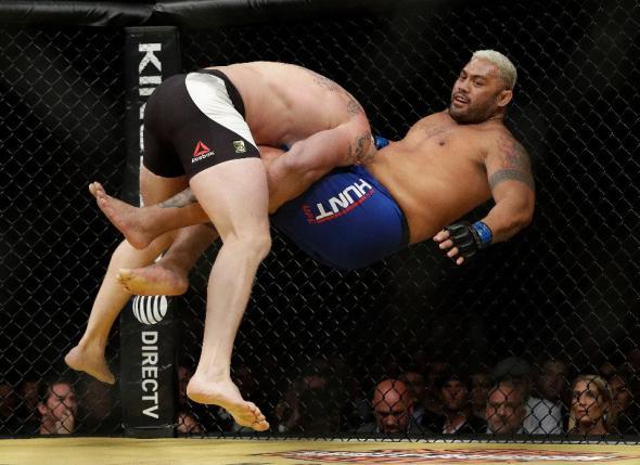 UFC: Dana White pictured with Brock Lesnar wearing a UFC T-shirt - Brock Lesnar