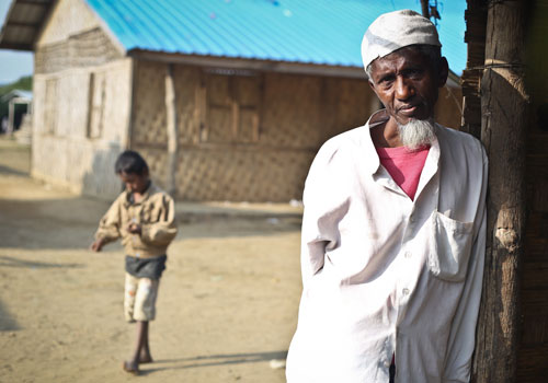 A Muslim man leans against a shelter in an IDP camp in Sittwe. (Yu Yu/The Myanmar Times)