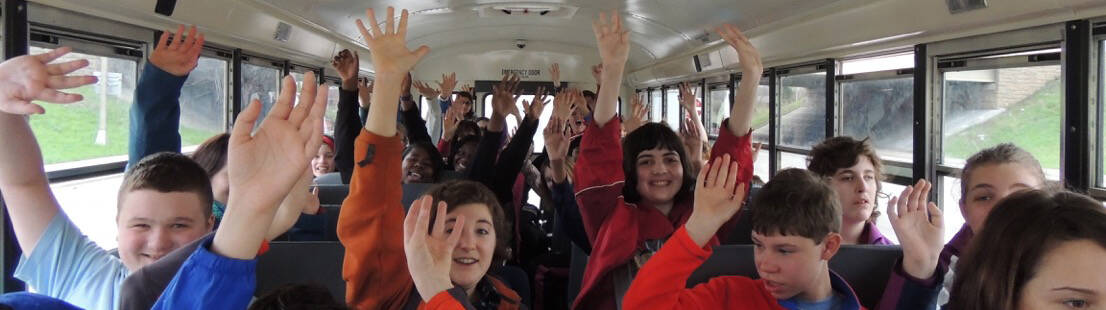 Excited Kids on a School Bus