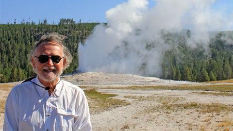 man in geyser wilderness
