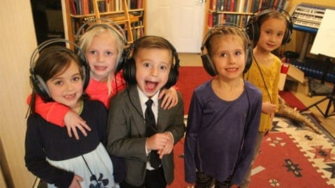 kids recording song dressed nice