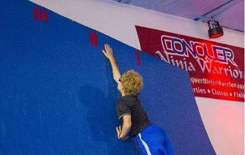 Kid on climbing wall