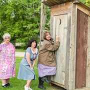 Ladies waiting at outhouse