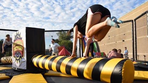 Kids running across balance beam