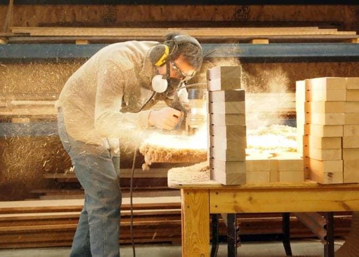 Man making musical instrument