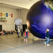 Students with giant models of the planets