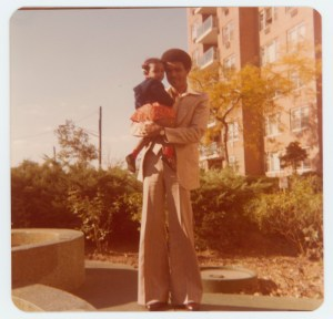 Eric Lafontant holding his daughter Farrah Lafontant in Flatbush, 1979. Donated by Farrah Lafontant.