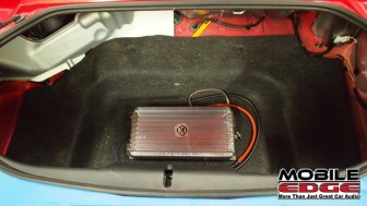 The Memphis amp is tucked away in the trunk well area. It will be visible through a stylish cutout in the floor trim piece.