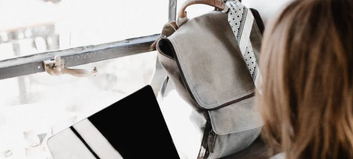 Researching with backpack and laptop