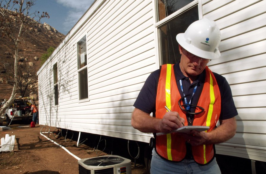 Man inspecting a mobile home