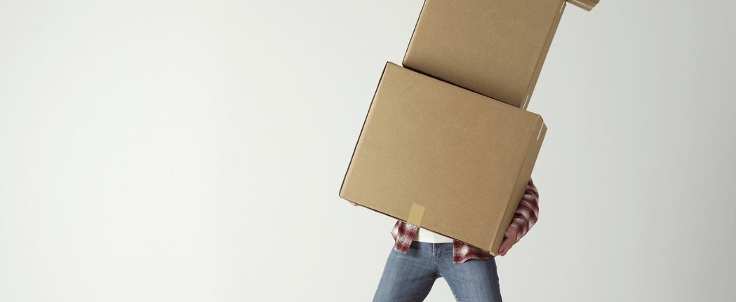 Man carrying boxes unsteadily