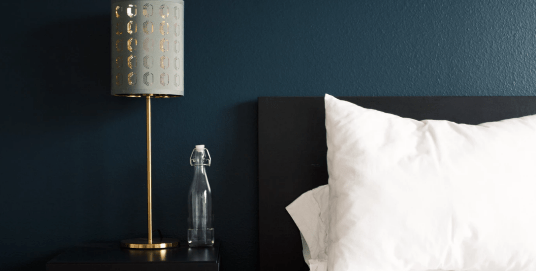 headboard against a dark blue wall