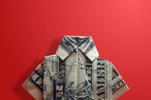Dollar folded into origami shirt