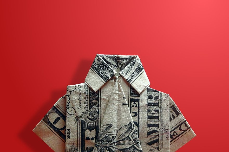 Dollar folded into origami shirt