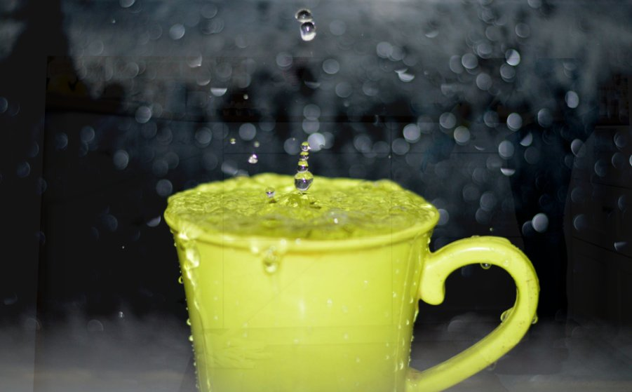 Green mug overfilled with water