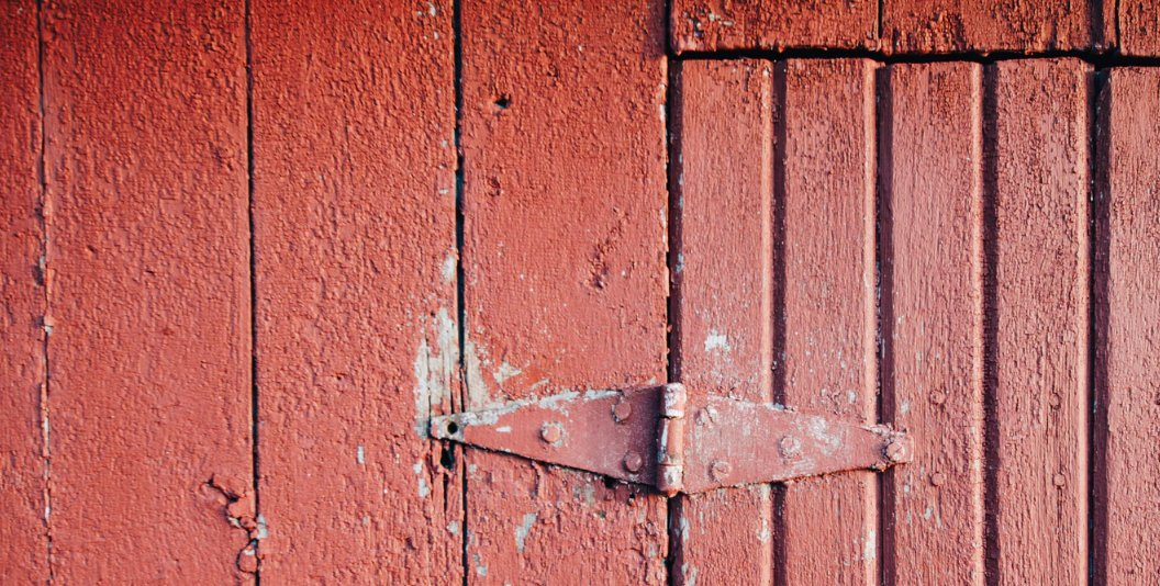 Painted red door hinge