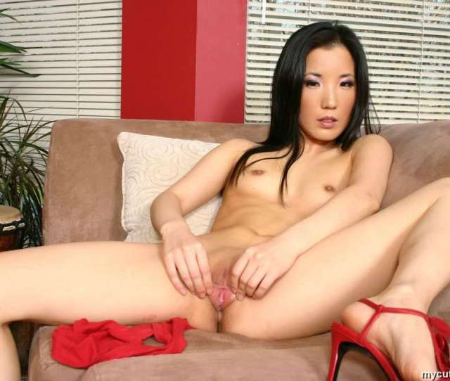 Asian Almond Tease Plays With Huge Blue Dildo