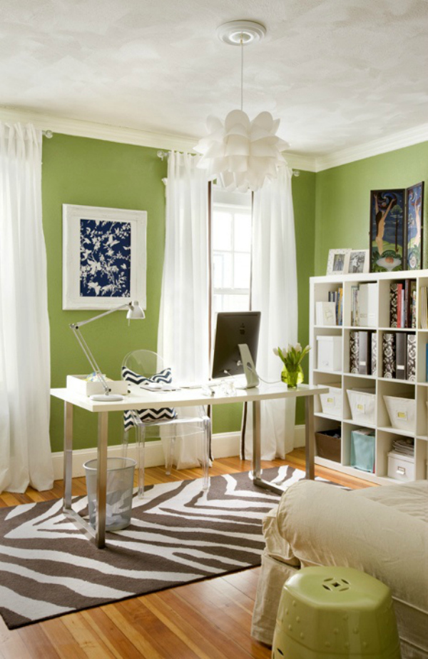 It has a gray bed that faces a light wood desk topped with a lovely decor. How to use colour in your home office to increase
