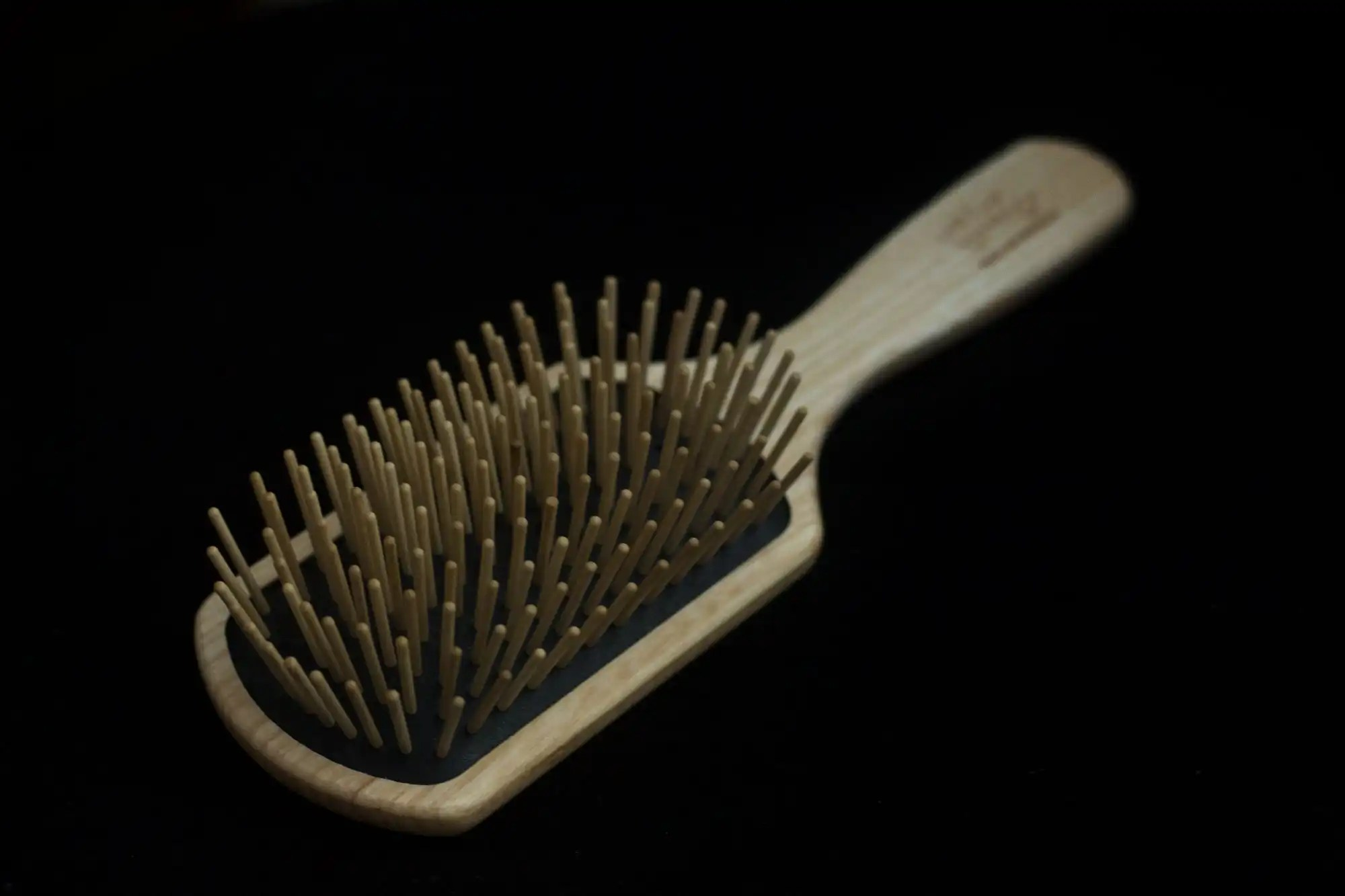 Widu Hair Brush on black background