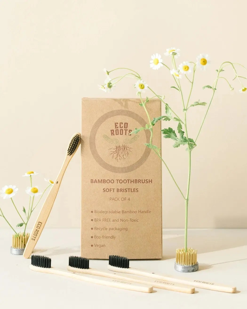 Zero waste store Eco Roots toothbrushes with flowers in the background