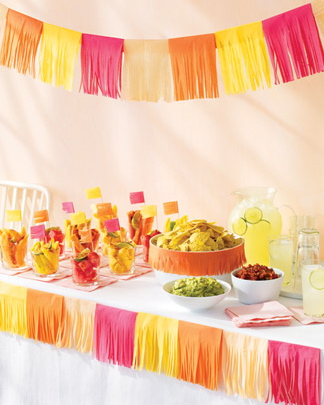 Deck out your buffet with a quick and easy tissue paper garland (via)