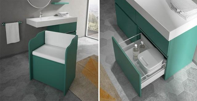 Mobile da bagno in colore verde scuro con cassettone portaoggetti e poltrona estraibile.