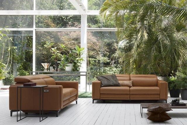 Doimo Salotti divano in pelle Evoque in contesto di casa urbano.