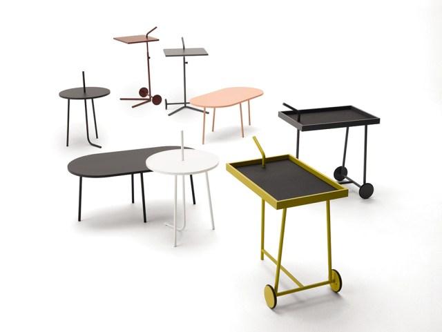 Tavolini dalle forme ovali e carrellino portavivande modelli level e bridge.