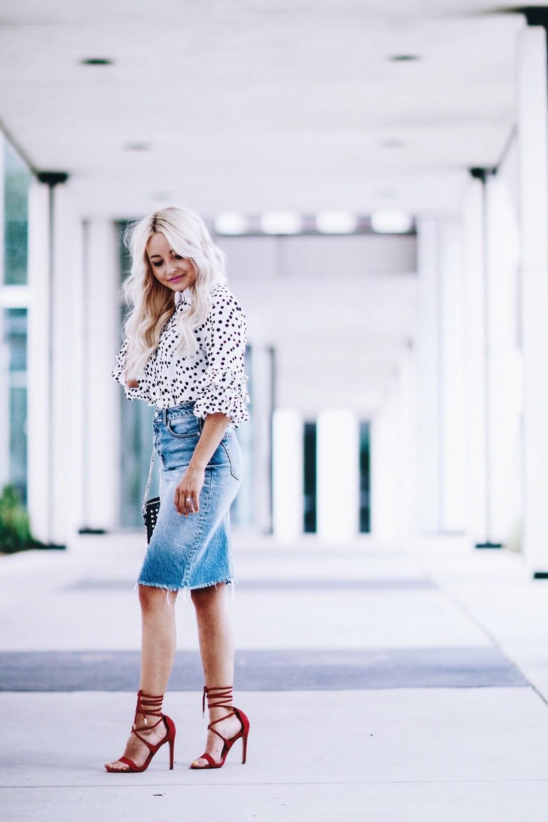 Alena Gidenko of modaprints.com styles a denim pencil skirt with a polka dot blouse