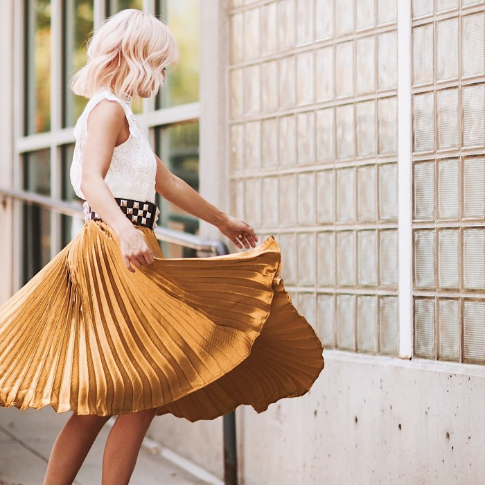 Alena Gidenko of modaprints.com styles a gold pleated skirt with a lace top for Fall