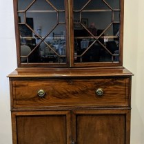 "**ITEM NOW SOLD** Antique English secretary, purchased from Jean Williams Antiques 25-30 yrs. ago. Drop front desk, fretwork glass doors. 43.25""w x 22.25""d x 83.25""h. Orig. List: $5000.- Modele's Price: 1395.-"