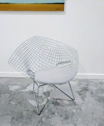** ITEM NOW SOLD.**Knoll Bertoia Diamond Chair. (small). Five years old. Purchased at Hive Modern. Seat pad: Tweed Frieze 'Silverbell'. Includes full seat cover in 'Bounce Aegean'. Current List with full cover:$1911.- Current list with seat pad:$1326.- Modele's Price: 895.-