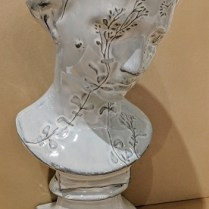 "Charming garden girl ceramic bust. 14.5""h 265.-"