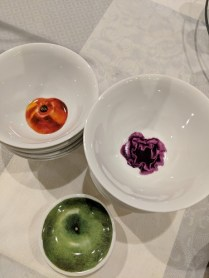 Driade (Italian co.) porcelain bowls with fruit/veg. motif. Never used. Set/7 'red apple' bowls 70.- Set/11 purple cabbage bowls 110. Set/6 'green apple' sauce bowl 50.