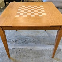 "**ITEM NOW SOLD** McKinnon game table. Solid cherry with maple inlay. Showroom sample, not used in a home. 36"" sq. x. 30""h. Orig. List: $1,599. Modele's Price: 750.-"