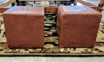 Pair American Leather Ottomans.Purchased at Room and Board approx 17 years ago. On Casters. 295.- pair