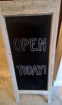 """Open Today"" charming sandwich board A-frame sign. Letters are painted on black board, both sides, bleached wood frame. 15.5""w x 18""d x 37.5""h. 75.-"