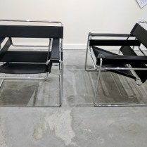 **ITEM NOW SOLD** Pair Fasem (Italian) Wassily-style modern chairs. Tubular steel frame. Leather sling seat, back and arms. Reproduction of Marcel Breuer's 'Wassily' chair. Purchased originally from Egbert's. Cat scratches on leather slings. Original List: $1295.-each. Modele's Price: 795.-/pair