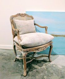 Vintage caned chair. Includes custom cushions made from French Linen. 350.-