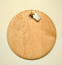 "Edward S. Wohl cutting board. .16"" round 155.-"