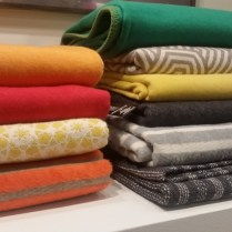 David Fussenegger throws, made in Austria. Machine washable. 85% cotton. Many patterns and colors available. Special orders arrive quickly. Price of throws ranges from 115. to 188. each.