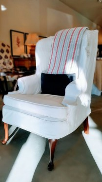 **ITEM NOW SOLD**Tall Wing-back Chair. Removable slip cover. Includes lumbar pillow. 295.-