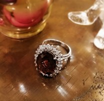 Ring: 18K white gold with 7.11 ctw oval checkerboard cut tourmaline, 78 points diamonds. Modern 2000.-