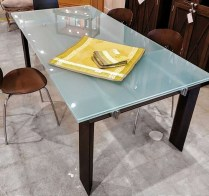 Roche Bobois Dining Table. Extendable glass top with wenge wood base. Original List: $9750.- (some scratches on surface). Modele's Price: 2250.-