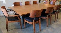 **ITEM NOW SOLD**Set. Gulassa & Co. Dining table and six side chairs and two arm chairs. Purchased in 2009. Walnut and steel. Table is 'Lockwood' and chairs are 'DG'. Hide seat covers. Original List. $41,000.- + /set Modele's Price: 17,500.- /set