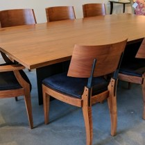 **ITEM NOW SOLD** Set. Gulassa & Co. Dining table and six side chairs and two arm chairs. Purchased in 2009. Walnut and steel. Table is 'Lockwood' and chairs are 'DG'. Hide seat covers. Original List. $41,000.- + /set Modele's Price: 17,500.- /set