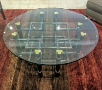 **ITEM NOW SOLD**McGuire coffee table. Professionally refinished dark stained base with brass caps. Thick round beveled glass top. 695.-